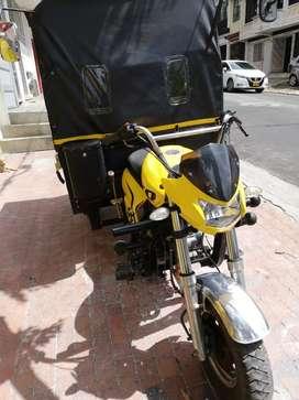 Vendo moto carga carpada