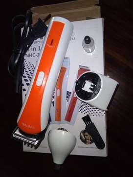 Máquina de cortar cabello portatil