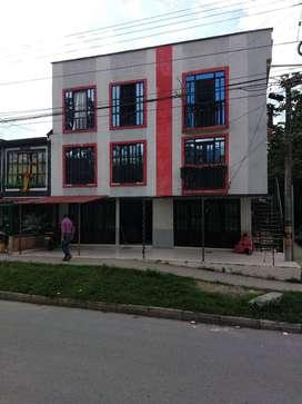 venta edifico de tres pisos con tres locales comerciales, y dos apartamentos, Produciendo renta mensual de $2.000.000,.