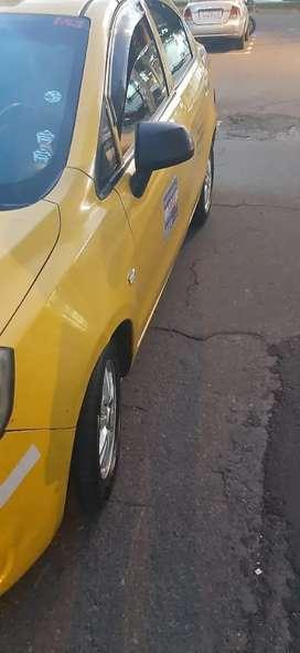 Puesto y carro en compañía de taxi
