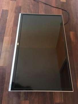 Tv lcd 32' impecable con soporte incluido de pared