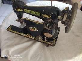 Máquina de coser súper dumton