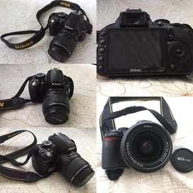 Se vende cámara niko D3100 con un lente de 18-55 con cargador y batería,estado 10/10