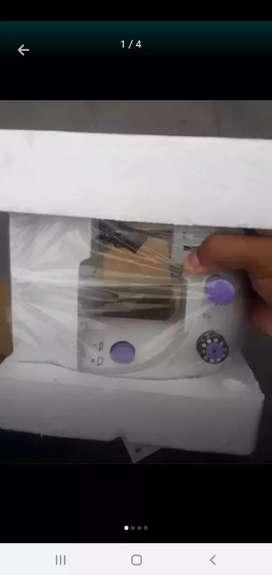 Mini maquina coser nueva