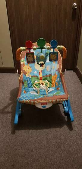 Mecedora bebe marca Fisher Price