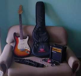 COMBO: Guitarra eléctrica Texas modelo Stratocaster + Amplificador Ross 10w y accesorios.