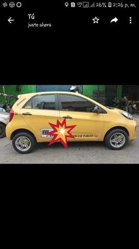 Taxi en venta buen estado.  Se vende con rines normales papeles al dia radio musical.