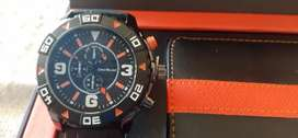 Reloj ,billetera y lapicera