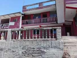 Venta de casa de cemento armado y terreno por motivo de viaje