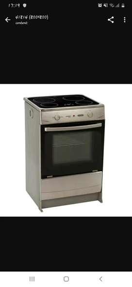 Se vende o cambia cocina de inducción nueva por máquina recta y overlock de medio uso