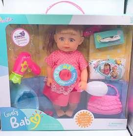 Muñeca que orina y hace sonidos
