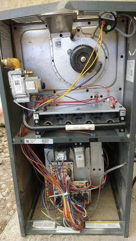 Equipo de calefacción central (aire calliente) Googman 23.500 KCal/h y termostato