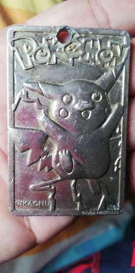 Tarjeta pokemon 1999 nintendo metal dorado