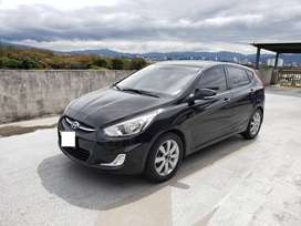 Hyundai Accent Blue Hatchback.