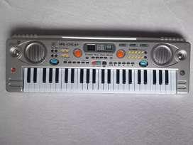 Piano Organeta Teclado 49 teclas USB nuevo para niños