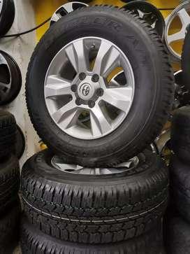 Rines 17 toyota hilux originales neumáticos bridguestone rf 265 65 17