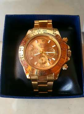 Reloj dorado unisex