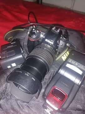 Camara nikon d7000,con lente 18-105,cargador y pila original, flash yongou 565ex. Exelente estado