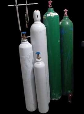 Oxigeno tanques y recarga,  CO2, gases industriales, regulador, cánula y vaso humidificador