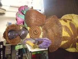 muñeca hecha del coco artesanal