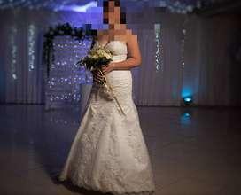 Se vende hermoso vestido de novia un solo uso, como nuevo.