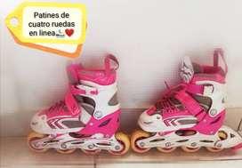 patines rosados de cuatro ruedas en linea.