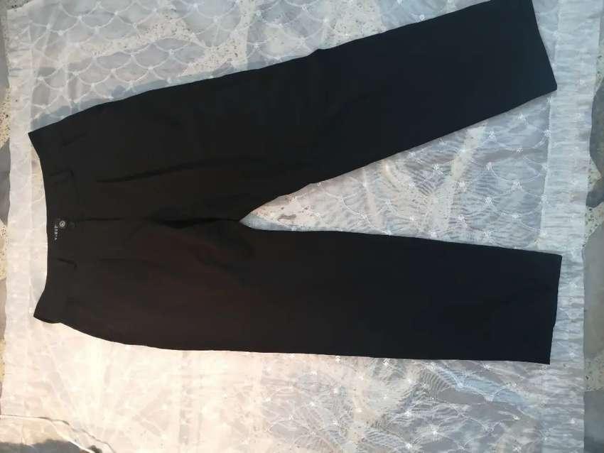 Pantalón en tela marca XAIROZ talla 14