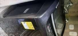 Hermosa lavadora whirlpool Americana 1 año uso negra 18 k.