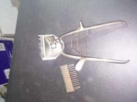 Maquina antigua de cortar pelusa