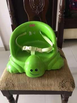 Asiento de niños pequeños adaptable marca fisher price para silla comedor
