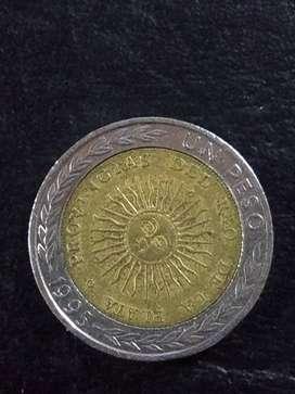 Moneda de un peso con error