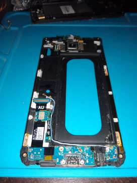 Samsung S7 edge solo lógica de carga, huella azul con desgaste, camara trasera y parlante de llamda, sensore de proximi