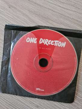 CD's Up All Night y Take Me Home de One Direction