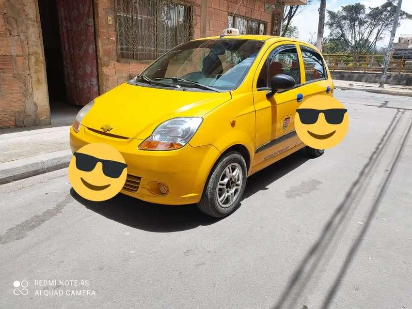 Vendo o cambio taxi Chevrolet Spark buen estado