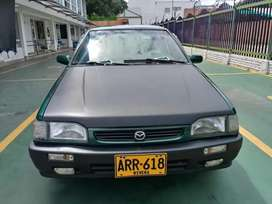 Venta de carro mazda 323 modelo 1998 papeles hasta diciembre, impuestos  al día alarma vidrios eléctricos