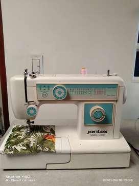 Vendo maquina jontex en muy buen estado hace costura recta ,sigzac tiene puntadas decorativas hace hojales