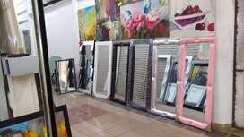 Espejos a costo 155*65 con el marco en cuerina marco de madera