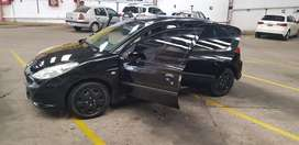 Peugeot 207 compac 5 puertas con GNC con aire y dirección. 120 mil km reales, Año 2010.