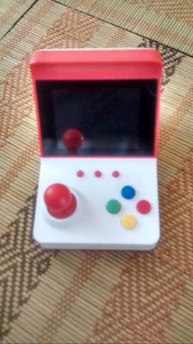 mini arcade consola + 2 controles extra + cable audio y video + cable de poder + 360 juegos NES