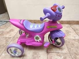Juguete Triciclo rosado con sonido