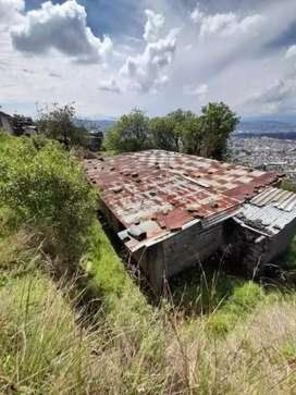 Terreno en venta con casa por areglar 50.000