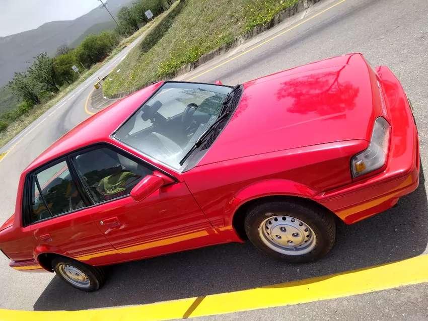 Mazda 323 año 95 colombiano impuestos al día vidrios eléctricos 0