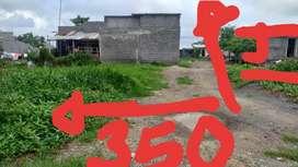 Vendo medio lote en el barrio mandala 2 etapa mide 350x14 lo entrego con paz y salvo y papeles autenticados