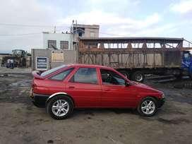 Vendo auto deportivo for escord año 98,rojo,mecánico, gasolinero, con aros de magnesio. Vendo por motivo de viaje