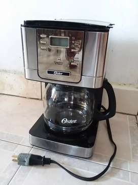 Cafetera progromable oster casi nueva