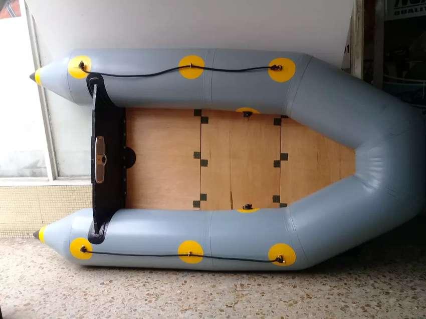 Bote inflable de piso plegable en madera 0