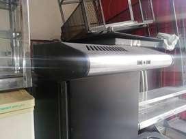 Campana extractora domestica con filtro de carbón activado.