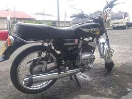 Rx 100 negra montada en 115