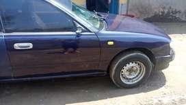 Vendo mi vehículo de marca Nissan bluebird Combustible GLP Carrocería. Sedan, ejes 2