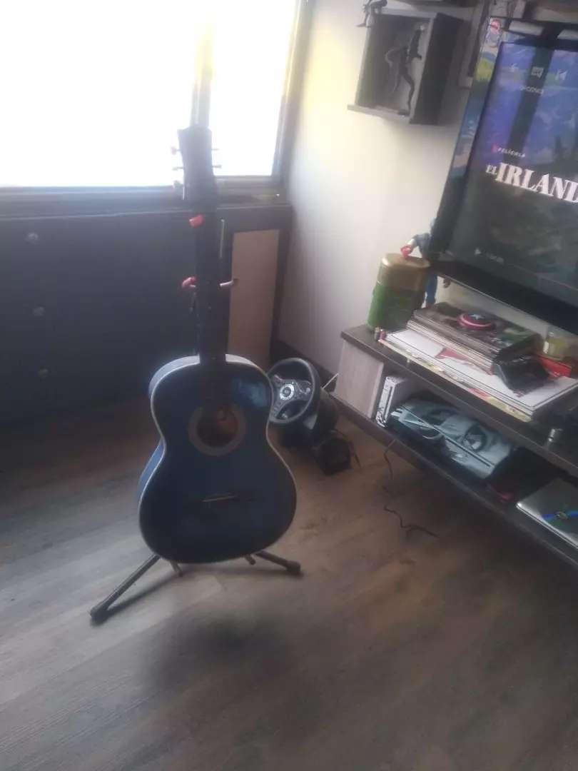 Guitarra con soporte